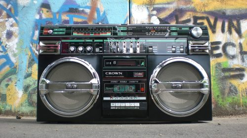 old radio in front of graffiti wall