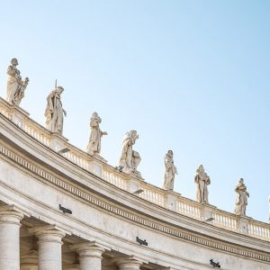 row of statues of saints against blue sky outside the Vatican